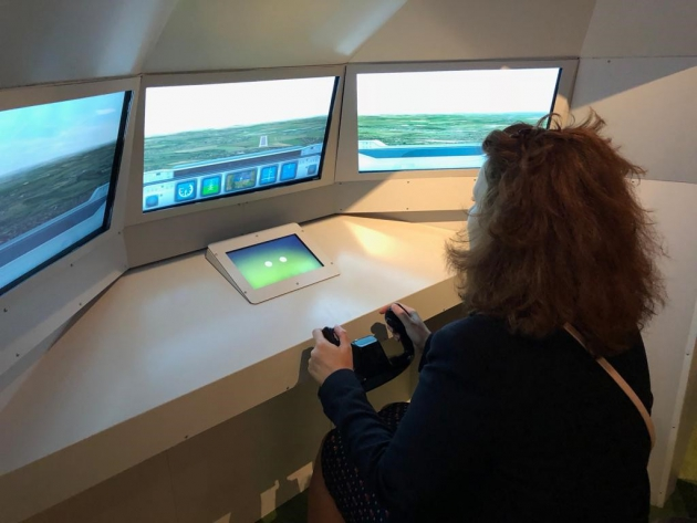 Visitors to the exhibition can try landing a plane in an A350 EGNOS simulator