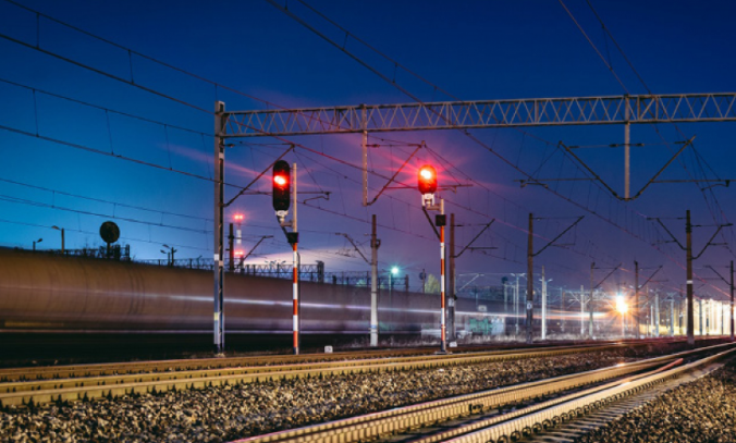 Railways and train during night with railways signaling