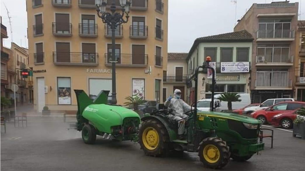 Tractor equipped with Smartomizer disinfecting the streets