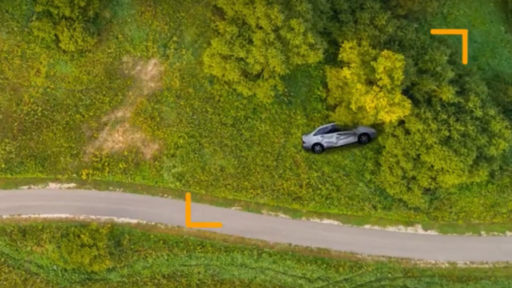 Top view of a car crashed at the countryside and activating the eCall