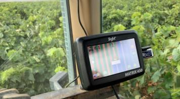 Tractor with an EGNOS-enabled guidance system from Teejet Technologies in action